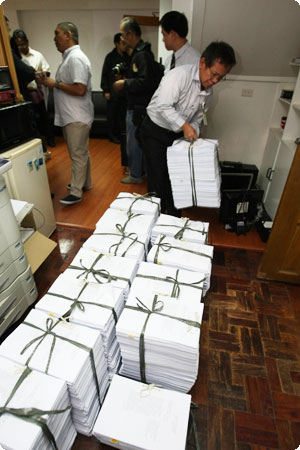 PAGCOR turned over piles of documents to the Department of Justice (DOJ) during the filing of plunder raps against former PAGCOR Chairman Efraim Genuino and 40 others on July 11, 2011. PAGCOR Chairman and CEO Cristino L. Naguiat, Jr. filed the case in behalf of the state-run gaming firm.